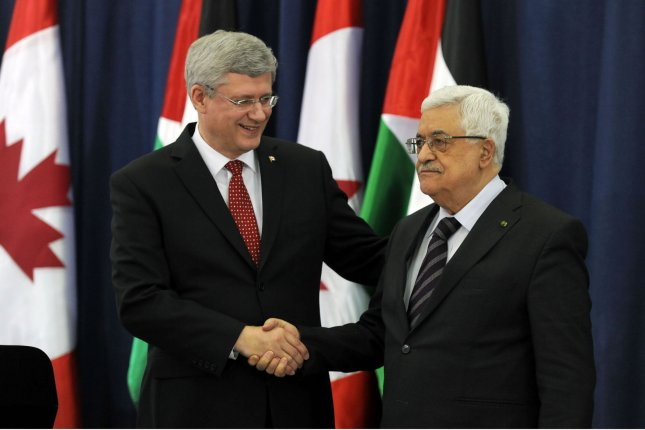 In this handout image supplied by the Palestinain Press Office (PPO), Palestinian President Mahmoud Abbas meets the Canadian Prime Minister Stephen Harper on January 20, 2014 in Ramallah, West Bank. UPI/Office of the Palestinian President/Handout Image