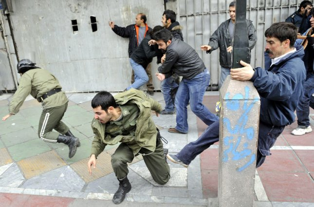 Iranians kick and chase police officers during demonstrations against President Mahmoud Ahmadinejad on December, 27, 2009 in Tehran, Iran. At least four protesters were killed during the clashes. UPI