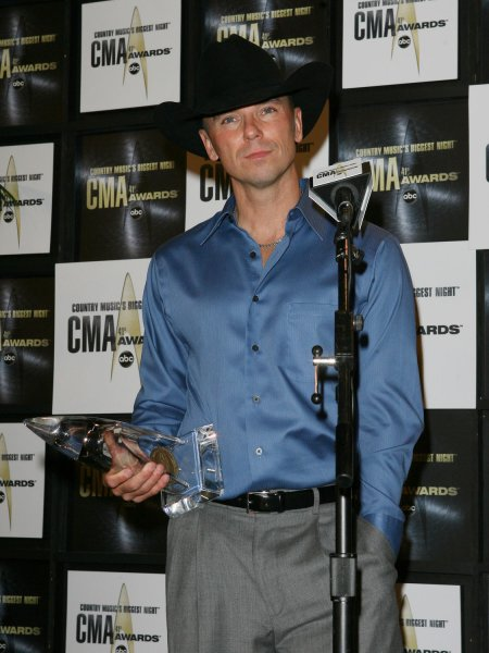 Kenny Chesney speaks to the press after being awarded Musical Event of the Year with Tracey Lawrence and Tim McGraw at the 41st annual Country Music Association Awards in Nashville, Tennessee on November 7, 2007. (UPI Photo/John Angelillo)
