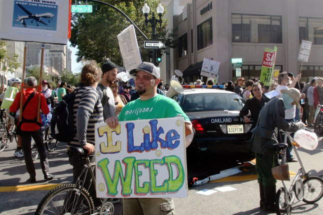 Several hundred protesters demonstrate at a medical marijuana and anti-war protest outside a fundraiser for President Barack Obama at the Fox Theater in Oakland, California on July 23, 2012. UPI/David Yee