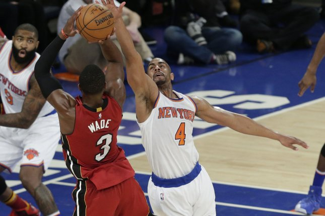 New York Knicks' Arron Afflalo leaps to defend Miami Heat Dwyane Wade who takes a shot in the first half at Madison Square Garden in New York City on November 27, 2015. Photo by John Angelillo/UPI