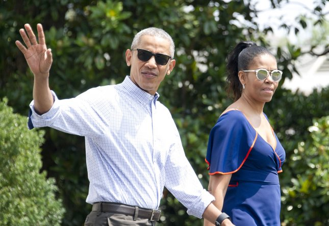 President Barack Obama and first lady Michelle Obama leave the White House on Saturday for a family vacation at Martha's Vineyard, Mass. Pool Photo by Ron Sachs/UPI