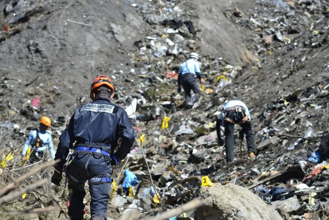 French police investigate after the Airbus A320 Germanwings passenger plane crashed into a mountain range of the French Alps on March 24, 2015. On the second anniversary of the crash, Gunther Lubitz said investigators' claims that his son, who co-piloted the plane, deliberately crashed it are false. Photo by Francis Pellier/MI DICOM/UPI