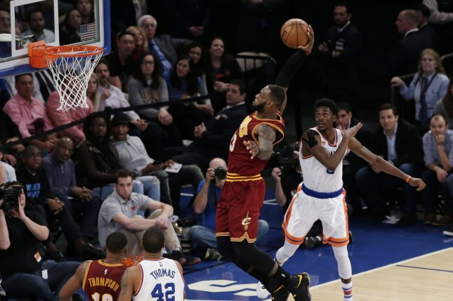 ecac215d284a Cleveland Cavaliers small forward LeBron James leaps and dunks the  basketball in the 2nd quarter against the New York Knicks at Madison Square  Garden in New ...