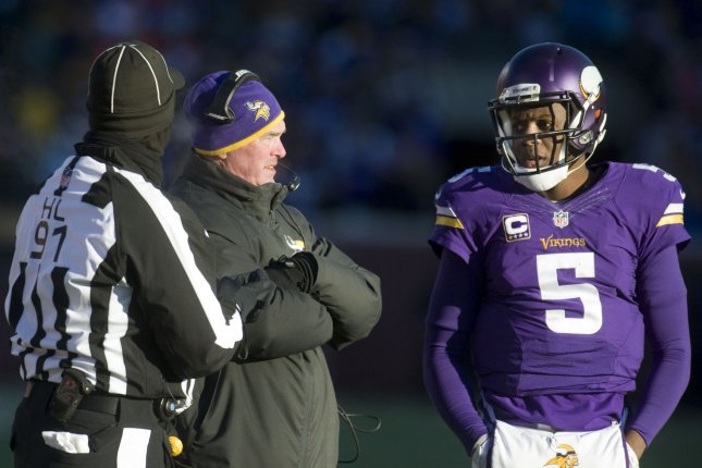 Minnesota Vikings head coach Mike Zimmer talks with quarterback Teddy Bridgewater (5) before attempting a punt against the Seattle Seahawks in the fourth quarter of their AFC Wild Card game at U.S. Bank Stadium in Minneapolis on January 10, 2016. File photo by Marilyn Indahl/UPI