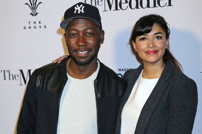 Hannah Simone (R) and Lamorne Morris spent the Fourth of July together following the New Girl series finale. File Photo by David Silpa/UPI