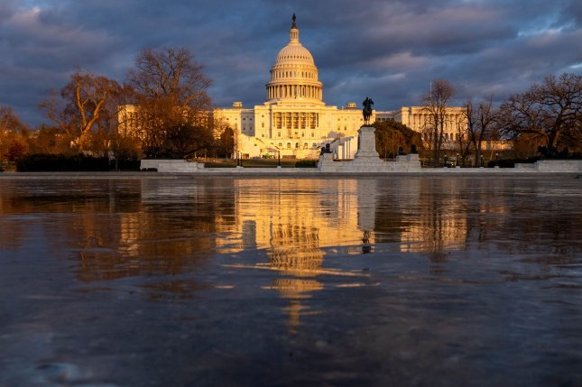 The U.S Capitol is seen in the reflecting pool in Washington, D.C., Friday. Officer Brian D. Sicknick, who died on January 7 from injuries sustained in the U.S. Capitol insurrection the previous day will become the fifth person to lie in honor in the U.S. Capitol Rotunda. Photo by Ken Cedeno/UPI
