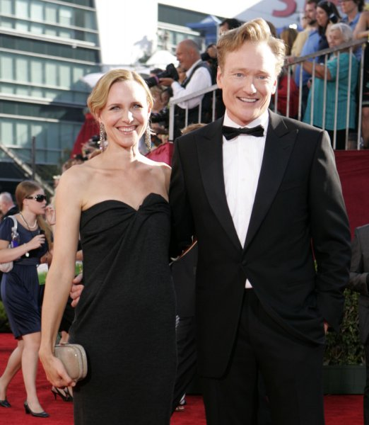Conan O'Brien (R) and wife Liza arrive at the 61st Primetime Emmy Awards at the Nokia Center in Los Angeles on September 20, 2009. UPI /Lori Shepler