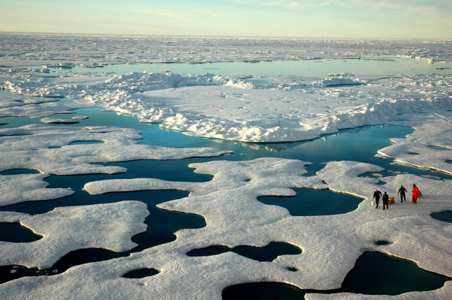 Scientists tread carefully through a seemingly endless landscape of ice, sea, and meltwater in the Canada Basin of the Arctic on July 22, 2005. UPI/Jeremy Potter/NOAA