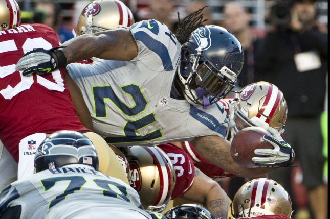 Seattle Seahawks Marshawn Lynch extends the ball over the goal line on a one yard TD in the first quarter against the San Francisco 49ers at Levi's Stadium in Santa Clara, California on October 22, 2015. The first possession drive was all the Seahawks needed as they defeated the 49ers 20-13. Photo by Terry Schmitt/UPI