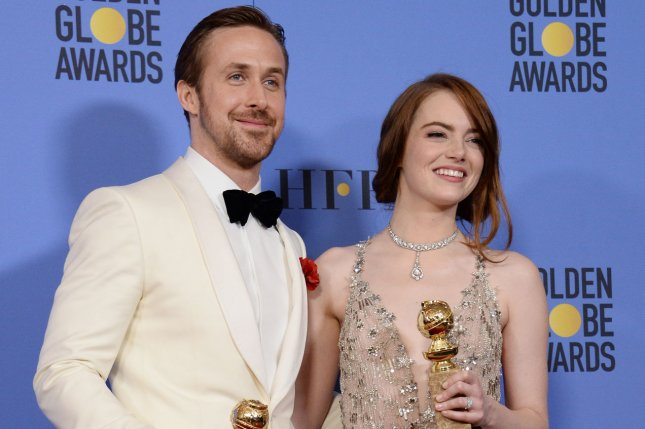 Ryan Gosling and Emma Stone, winners of the awards for Best Performance by an Actor and Actress in a Motion Picture Musical or Comedy for La La Land, appear backstage with their trophies during the 74th annual Golden Globe Awards on January 8, 2017. La La Land has been nominated for 11 BAFTA awards alongside Arrival and Nocturnal Animals with nine. Photo by Jim Ruymen/UPI