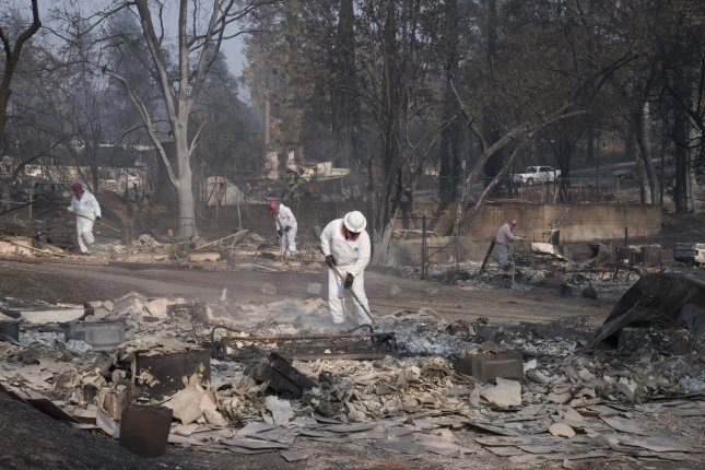 California wildfire almost  contained, but hundreds still missing