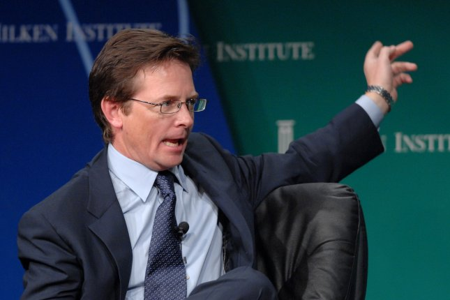 Researchers say that focus on higher acetylcholine levels and lower dopamine levels in Parkinson's disease patients, rather than just dopamine, could lead to better treatment methods. Pictured is actor Michael J. Fox, who was diagnosed with Parkinson's in 1991. File Photo by Jim Ruymen/UPI