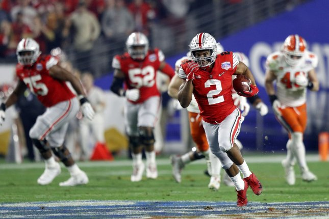 Ohio State Buckeyes star running back J.K. Dobbins (2) had 18 carries for 174 yards and one touchdown against the Clemson Tigers in the College Football Playoff semifinal game Saturday at the Fiesta Bowl in Glendale, Ariz. Photo by Aaron Josefczyk/UPI