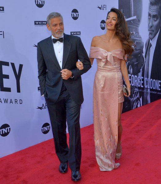George Clooney and his wife, human rights attorney Amal Clooney, arrive for American Film Institute's 46th annual Life Achievement Award tribute gala at the Dolby Theatre in the Hollywood section of Los Angeles on June 7, 2018. Clooney turns 60 on May 6. File Photo by Jim Ruymen/UPI