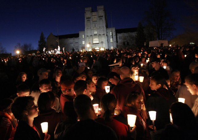 Virginia Tech students, teachers and others attend a candlelight vigil in front of Burress Hall April 17, 2007, the day after a gunman killed 32 people on the campus.. File Photo by Saul Loeb/UPI