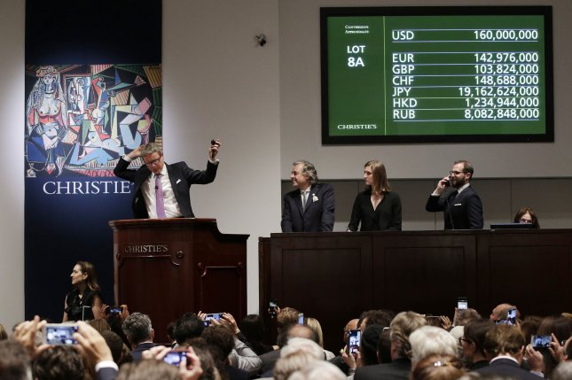 Christie's Auctioneer Jussi Pylkkanen concludes an auction of a painting by Pablo Picasso entitled Les femmes d'Alger at Christie's in New York City on May 11, 2015. The Picasso sold for a record $179,365,000 (including Christie's commission of just over 12 percent). Previously the most expensive art work ever sold at auction is Francis Bacon's Three Studies of Lucian Freud, which went for $142 million in 2013. Photo by John Angelillo/UPI