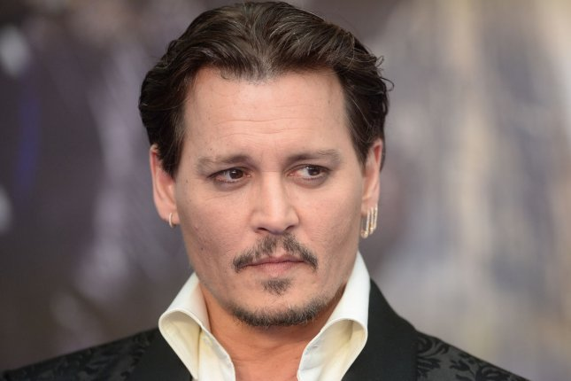 Johnny Depp attending the premiere of Alice Through The Looking Glass on May 10, 2016. Depp's domestic violence hearing with Amber Heard has been pushed back two days. File Photo by Rune Hellestad/ UPI