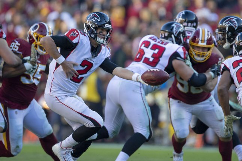 Atlanta Falcons quarterback Matt Ryan hands off the ball against the Washington Redskins in the second quarter on November 4 at FedEx Field in Landover, Md. Photo by Tasos Katopodis/UPI