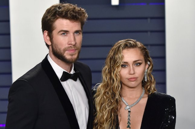 Miley Cyrus (R), pictured with Liam Hemsworth, honored Janice Freeman in an emotional speech and performance. File Photo by Christine Chew/UPI