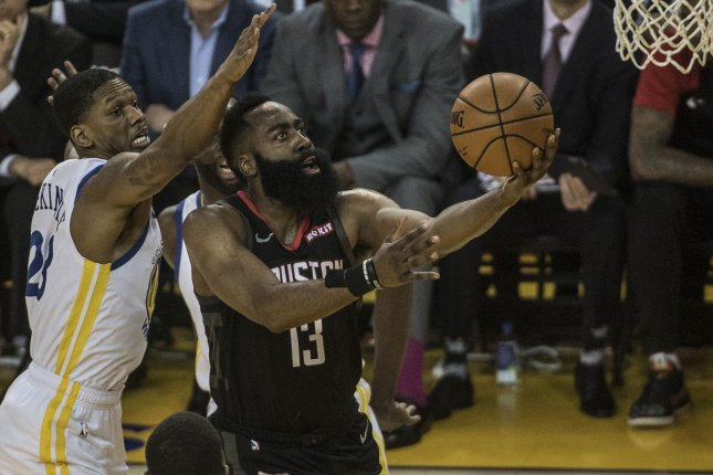 Houston Rockets guard James Harden (13) scored 38 points in the Rockets' 112-108 win over the Golden State Warriors in Game 4. File Photo by Terry Schmitt/UPI