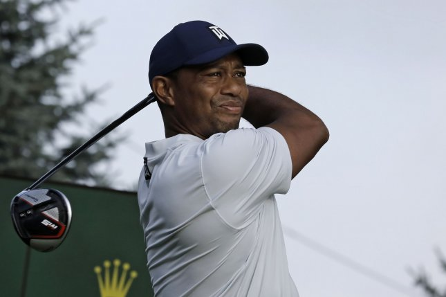 Tiger Woods complained of back problems three weeks ago in Los Angeles. The back ailment forced him to skip the Honda Classic and the WGC-Mexico Championship last month. File Photo by Peter Foley/UPI