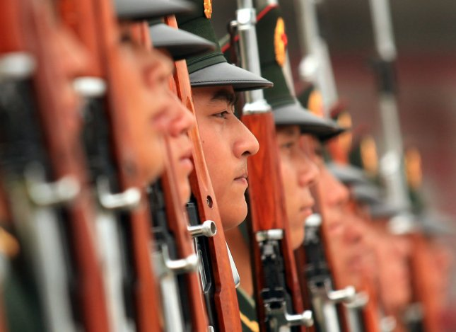 Soldiers from China's People's Liberation Army 'Guard of Honor' train at their barracks in Beijing on July 21, 2011. China's military is growing in a secretive way, raising the risk of conflict due to misunderstanding and miscalculation, according to a report by the U.S. Department of Defense. UPI/Stephen Shaver