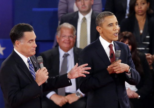 President Barack Obama (R) and Republican nominee Mitt Romney speak at the same time during the second presidential debate at Hofstra University in Hempstead, N.Y., last week. UPI/John Angelillo