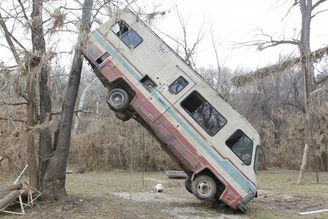 A recreational vehicle sits wedged against a tree along the Meramec River in Eureka, Mo., on Wednesday. The most severe damage from flooding occurred in the St. Louis region where heavily populated communities, including many that had never before been flooded, were inundated by floodwaters from the Meramec, Bourbeuse and Mississippi rivers. Governor Jay Nixon says that, based on geospatial imagery of the inundated areas, an estimated 7,100 structures were impacted in Franklin, Jefferson, St. Charles, and St. Louis counties, resulting in up to a half-million tons of debris, according to estimates. Photo by Bill Greenblatt/UPI