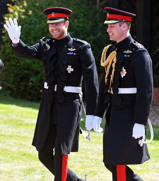 Britain's Prince Harry (L) and his brother and best man Prince William, duke of Cambridge arrive for the royal wedding on Saturday. Pool Photo by Neil Hall/UPI
