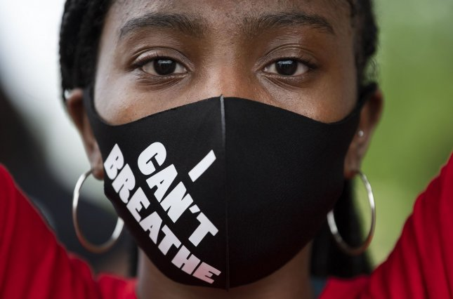 A protester participates in a rally at the U.S. Capitol against police brutality and the death of George Floyd on June 3, 2020, in Washington, D.C. Photo by Kevin Dietsch/UPI