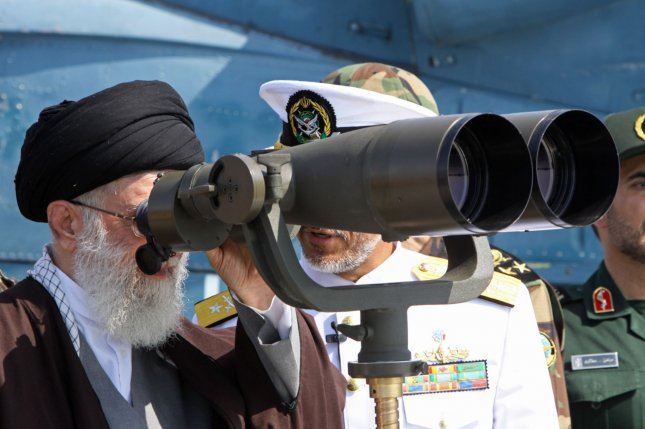 Iranian Supreme Leader Ayatollah Ali Khamenei looks through binoculars during the delivery of the first indigenously designed and developed guided-missile destroyer Jamaran in southern Iran, on February 19, 2010. This handout photo was made available by the official website of Khamenei. UPI/HO