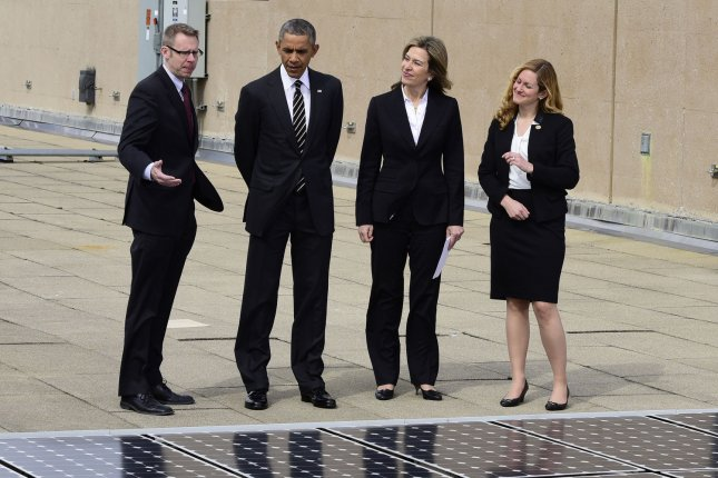 United States President Barack Obama looks at solar panels installed on the roof of the U.S. Department of Energy in Washington, D.C. on Thursday, March 19, 2015. From left to right: Eric Haukdal, Department of Energy Energy Manager, The President, Liz Sherwood-Randall, Deputy Secretary of Energy, and Kate Brandt, Federal Chief Sustainability Officer. Pool Photo by Ron Sachs/UPI