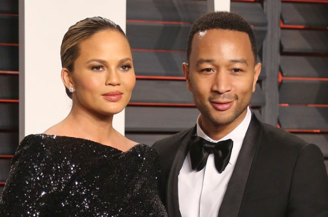 Chrissy Teigen (L) and John Legend at the Vanity Fair Oscar party on February 28. The couple welcomed daughter Luna on April 14. File Photo by David Silpa/UPI