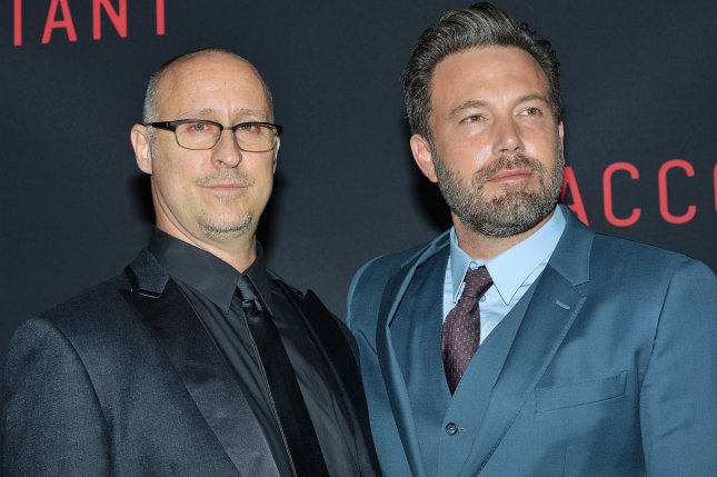 Ben Affleck and director Gavin O'Connor arrive at the Los Angeles world premiere of The Accountant in Los Angeles on October 10, 2016. O'Connor is writing and will direct Suicide Squad 2. File Photo by Christine Chew/UPI