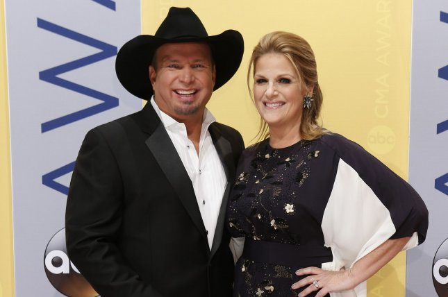 Garth Brooks (L) and wife Trisha Yearwood arrive at the 2016 Country Music Awards on November 2. Yearwood shared on Instagram Thursday a photo of her dressed as Brooks. File Photo by John Sommers II/UPI