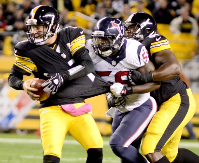 Houston Texans linebacker Whitney Mercilus forces Pittsburgh Steelers quarterback Ben Roethlisberger to fumble during a game in 2014. File photo by Archie Carpenter/UPI