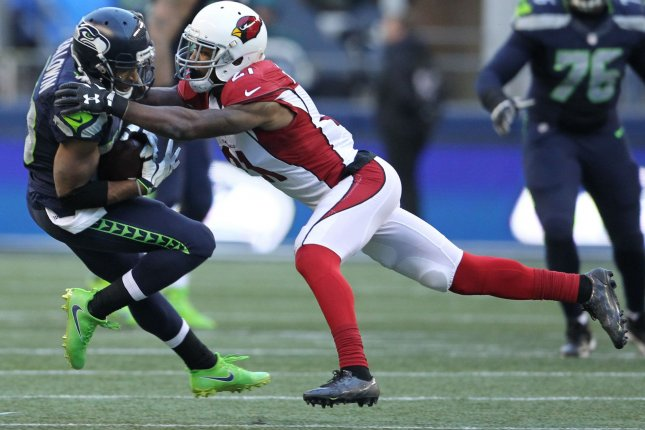Arizona Cardinals cornerback Patrick Peterson (R) won't be eligible to play until Week 7 of the 2019 season after being suspended for violating the NFL's performance-enhancing drug policy. File Photo by Jim Bryant/UPI