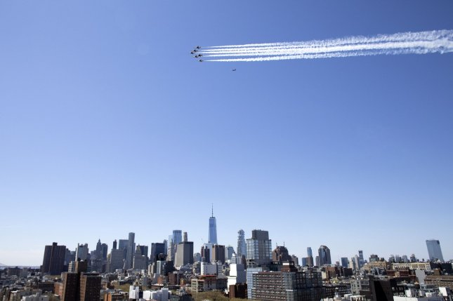 The U.S. Navy Blue Angels fly in formation over Manhattan in New York City on Tuesday as a tribute to front-line health workers. Similar flyovers will be staged in New Jersey and Pennsylvania. Photo by John Angelillo/UPI