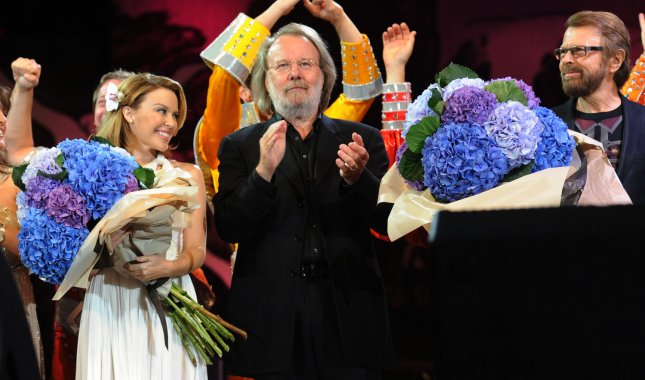 Australian singer Kylie Minogue and Swedish composers Benny Andersson and Bjorn Ulvaeus from ABBA at Thank You For The Music: A Celebration Of The Music Of ABBA in Hyde Park in London on September 13, 2009. UPI/Rune Hellestad