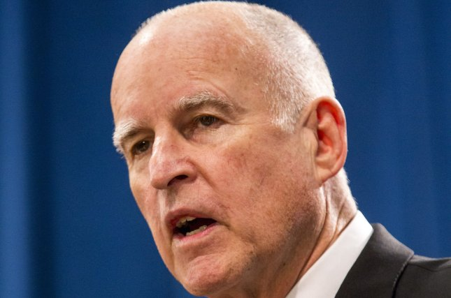 California Gov. Jerry Brown reviewed 61 bills as the legislative deadline approached. The bills dealt with gun control, sexual assaults on college campuses, ride-sharing companies like Uber and more. Photo by Ken James/UPI