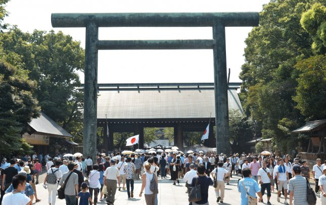 Visitors enter the Yasukuni Shrine in Tokyo, Japan, on Aug. 15. China and South Korea scolded Japanese officials for a Sunday visit to the controversial shrine dedicated to the war dead. File Photo by Keizo Mori/UPI