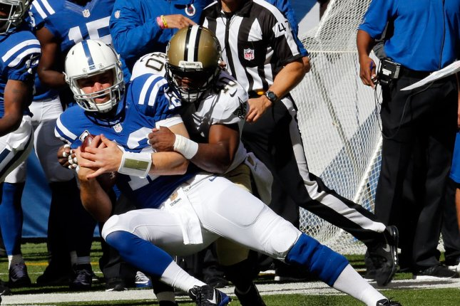 Indianapolis Colts quarterback Andrew Luck (12) tackled by New Orleans Saints' Delvin Breaux (40) during the first half of play at Lucas Oil Stadium in Indianapolis, Indiana, October 25, 2015. Photo by John Sommers II/UPI