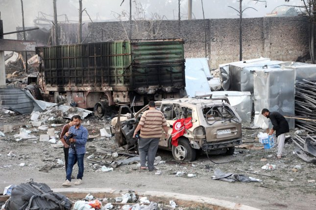 Syrian citizens survey burning and damaged trucks that had been carrying relief aid to the city of Aleppo, Syria, when they were attacked by airstrikes. The convoy included 31 trucks when it was hit in the town of Orum al-Kubra on the western outskirts of Aleppo, Sept. 20, 2016. Friday, NBC News cited two U.S. officials as saying American officials are becoming more worried about an offensive that's being planned by pro-government forces to take Aleppo. Photo by Omar Haj Kadour/ UPI