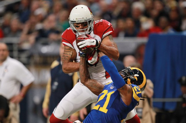 Former Arizona Cardinals wide receiver Michael Floyd (15) fights with then-St. Louis Rams cornerback Janoris Jenkins (21) for the football in the second quarter on December 6, 2015 at the Edward Jones Dome in St. Louis. File photo by Bill Greenblatt/UPI