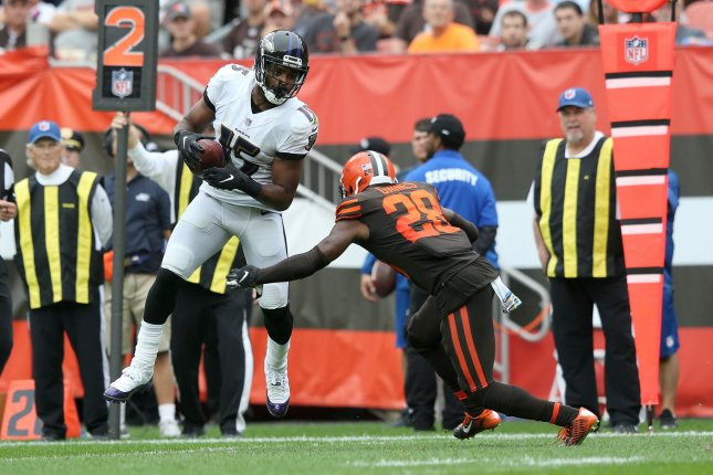 Baltimore Ravens wide receiver Michael Crabtree (15) makes a catch in front of Cleveland Browns cornerback E.J. Gaines in the second half on October 7, 2018 at FirstEnergy Stadium in Cleveland, Ohio. Photo by Aaron Josefczyk/UPI