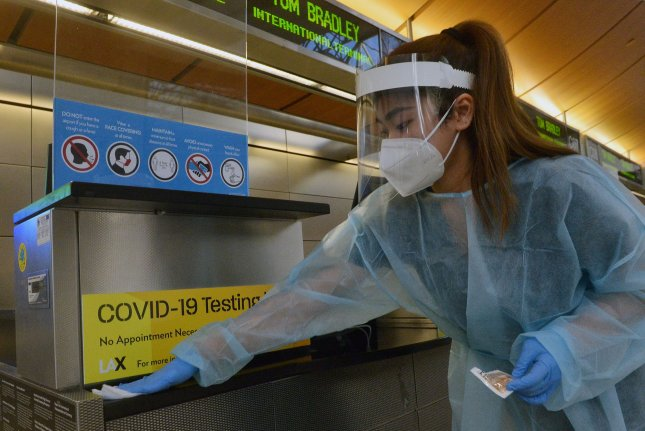 A worker disinfects a counter at Los Angeles International Airport on November 18. The average number of hospitalizations in Los Angeles County are about 10 times higher after the New Year compared to early November. File Photo by Jim Ruymen/UPI