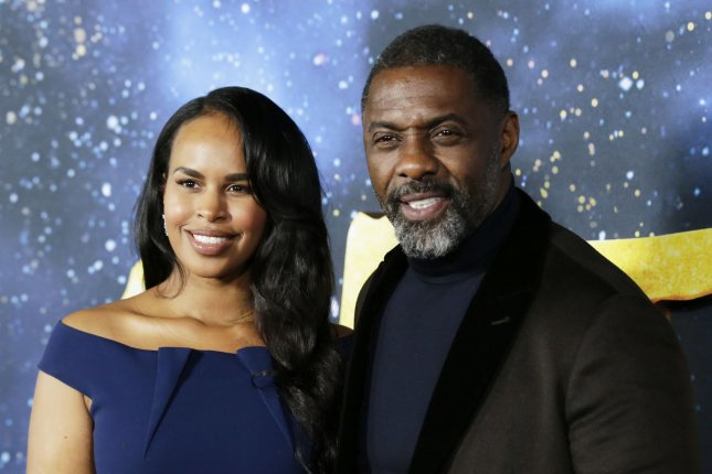 Idris Elba (R) and his wife, Sabrina Dhowre Elba, arrive at the premiere of Cats on December 2019. Elba's Green Door Pictures has entered into a joint venture with Archery Pictures. File Photo by John Angelillo/UPI