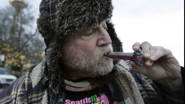 A medical marijuana user, smokes at a public consumption of marijuana on December 6, 2012 in Seattle. In November, Washington state jumped into history becoming the first state along with Colorado to legalize recreational marijuana use. UPI/Jim Bryant