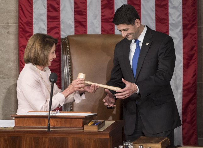House Minority Leader Nancy Pelosi hands the gavel to Speaker Paul Ryan after he was re-elected Speaker of the House at the opening of the 115th Congress on Tuesday. Photo by Kevin Dietsch/UPI